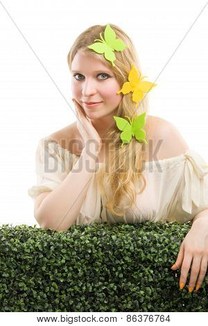 Beautiful blonde woman with butterfly decoration.