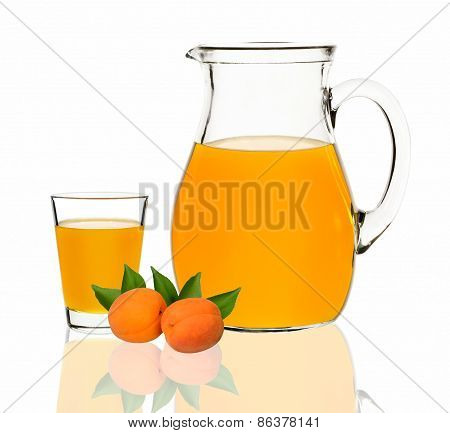 Apricot Juice In A Glass And Carafe On A White Background