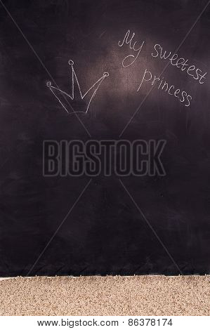 Close Up Of A Black Dirty Board With The Words My Sweetest Princess And Crown