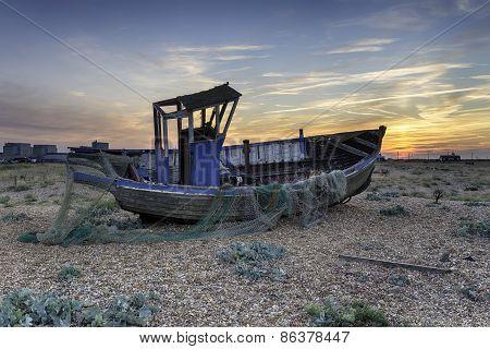 Dramatic Sunset Over Fishing Boat