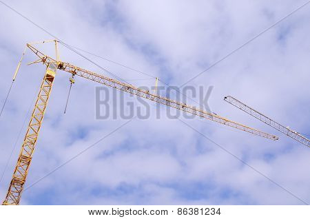 Construction Crane In Cloudy Sky