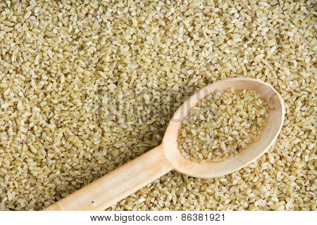 Cracked Wheat Background Texture With Angled Spoon