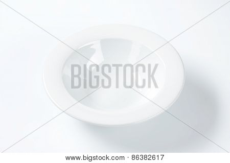 empty white soup plate on white background