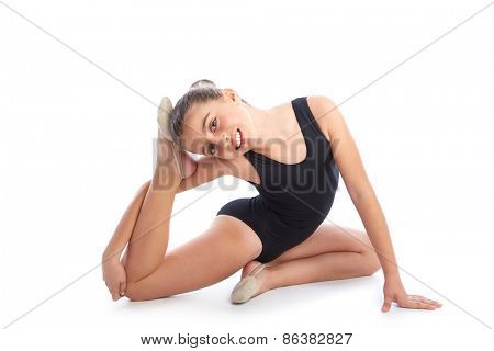 Kid girl rhythmic gymnastics exercises on white background