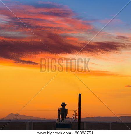 Industrial chimney at sunrise in Paterna Valencia at Spain