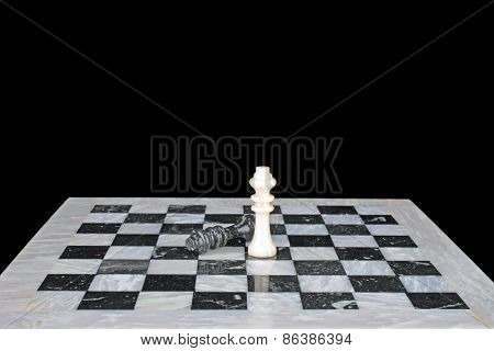 The winner. King beats the king, chess play on a marble chess board