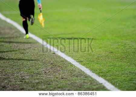 Assistant Referee In Action On A Soccer Field