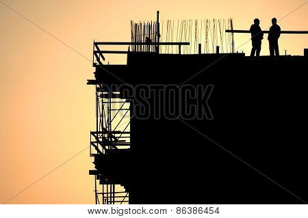 Construction Workers Silhouettes At Sunset
