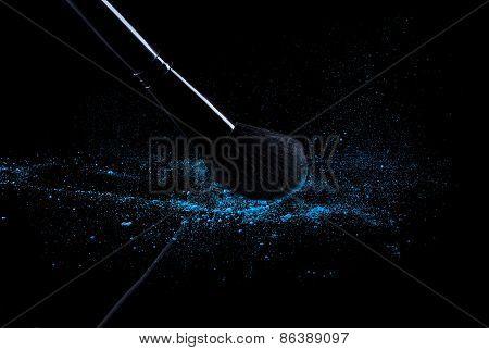 Brush With Blue Powder Isolated On Black