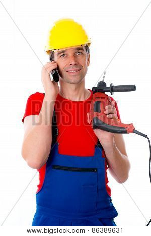 Worker With Drilling Machine Is Calling