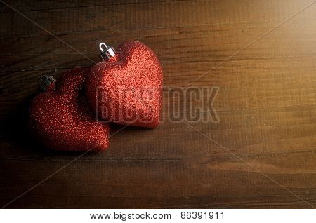 Couple Red Heart On Wooden Table For Valentine's Day