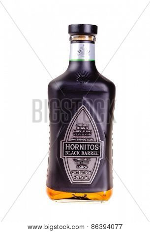 Hayward, CA - March 21, 2015: Bottle of Hornitos Black Barrel tequila anejo isolated on white - illustrative editorial