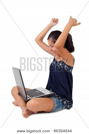 Teenager Exults With Arms Up With The Laptop.