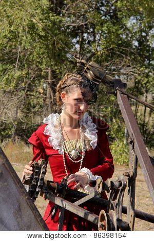 Woman in steampunk dress with machinery
