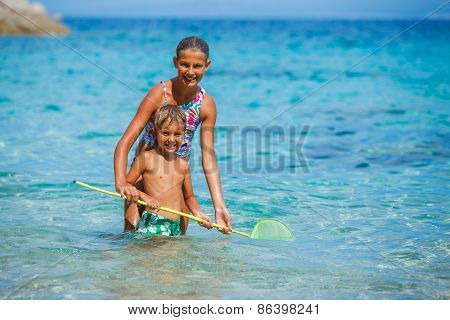 Kids playing in the sea