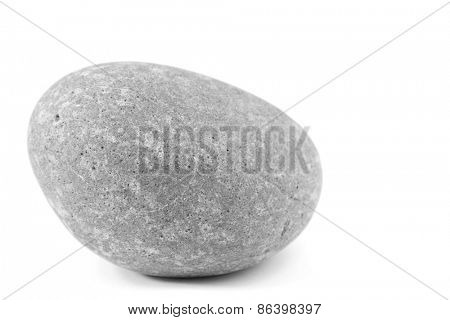 Closeup of one rock on plain background