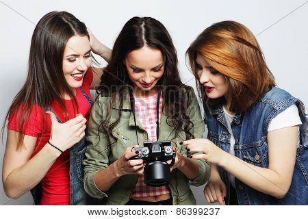 three young girls looking at camera, studio shot