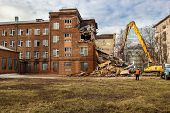 picture of earth-mover  - excavator demolishes old soviet school building in moscow  - JPG
