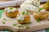 foto of portobello mushroom  - Mushrooms stuffed with blue cheese microgreens on top simple delicious food snack  - JPG