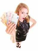 picture of currency  - Rich happy blonde business woman showing euro currency money banknotes. Economy finance and business work.