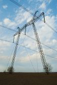 stock photo of power transmission lines  - Powerful line of electric power transmission on steel supports - JPG