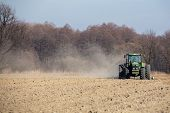foto of plow  - Sowing and plowing action in the spring season - JPG