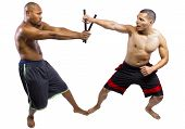 pic of filipino  - Two muscular martial artists demonstrating the Filipino Martial Art Kali Escrima or Arnis - JPG