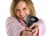stock photo of housecoat  - Young woman with hair dryer isolated on white background - JPG