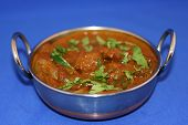 picture of kadai  - traditional indian chicken curry in a kadai garnished with corainder and chillies - JPG