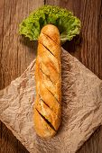 pic of butter-lettuce  - Garlic baguette with lettuce on a wooden table - JPG