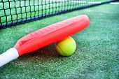 picture of paddling  - Paddle tennis racket and ball in paddle tennis field  - JPG