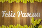 stock photo of pasqua  - feliz pasqua against wooden surface with planks - JPG