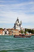 Venice, Basilica Santa Maria Della Salute And Tourist Boat poster