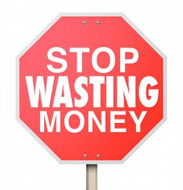 picture of waste reduction  - Stop Wasting Money words on a red warning sign telling you to cut overbudget spending and avoid debt and bankruptcy - JPG