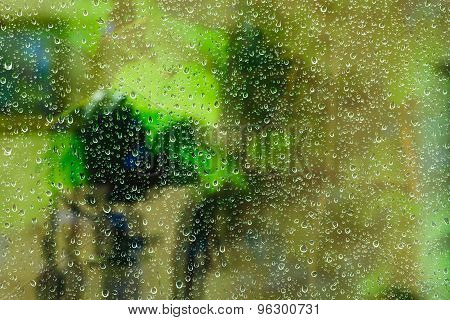 Green Background From Raindrops On Window Glass