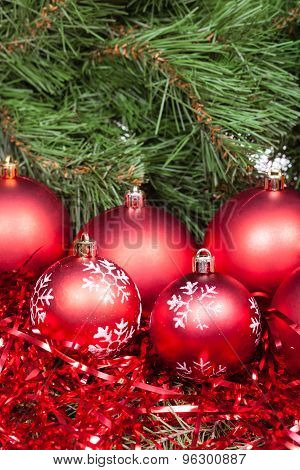 Several Red Christmas Balls, Tinsel And Xmas Tree