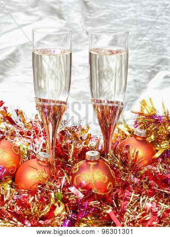 Glasses Of Champagne With Orange Xmas Decorations