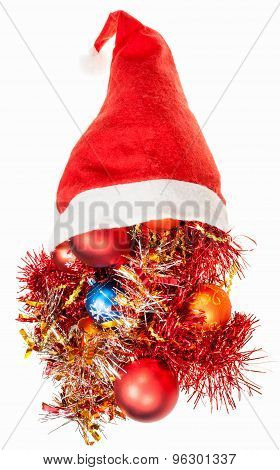Christmas Decorations Spill Over Red Santa Hat