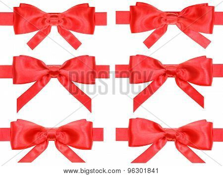 Set Of Red Bow Knots On Satin Ribbons Isolated