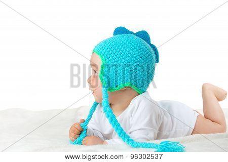 Baby in dinosaur hat