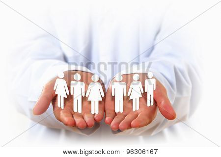 Close up of human hands with row of people figures