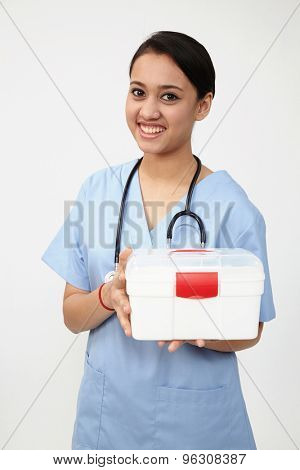 female nurse or doctor carrying a portable first aid kit isolated on white