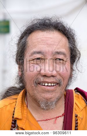 Old Tibetan Buddhist Monk In The Dharamsala, India