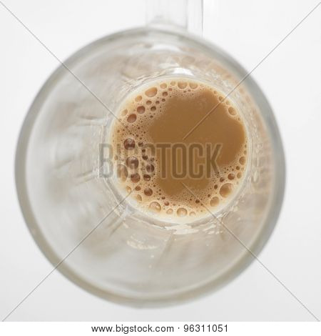 Top view of lnearly empth glass with little Tea with milk or Teh Tarik in Malaysia
