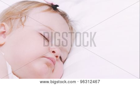 Close Up Portrait Of Little Sleeping Baby Girl