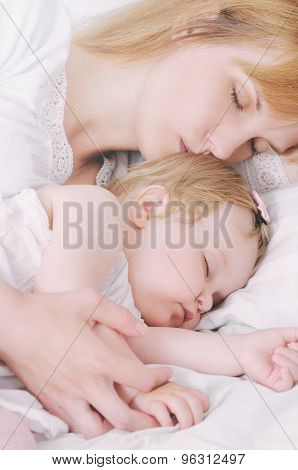 Little Sleeping Baby Girl With Her Caring Mother
