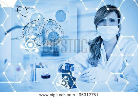 Science graphic against chemist working in protective suit with futuristic interface showing a brain