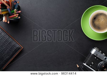 Office leather desk table with coffee cup, camera and supplies. Top view with copy space