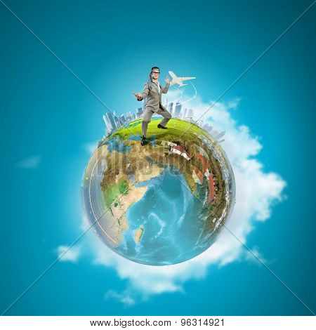 Cheerful young businessman with tie around head. Elements of this image are furnished by NASA