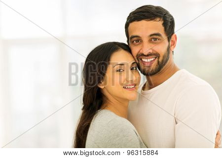 portrait of smiling indian couple looking at the camera